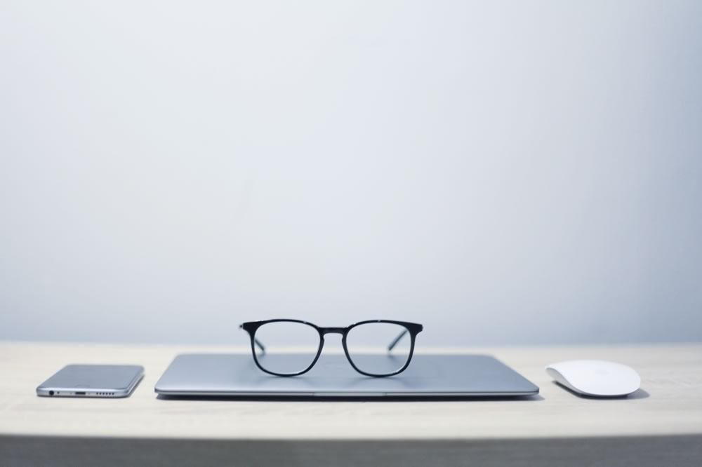 Image of glasses on a closed laptop